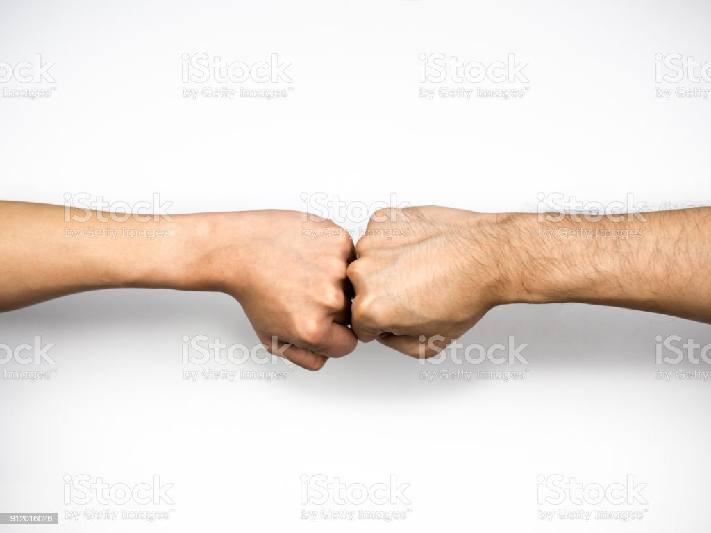 Fist bump on white background, close up stock photo