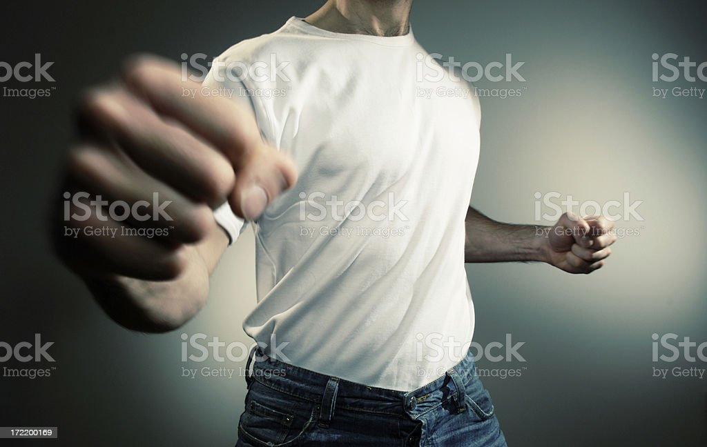 Fist Fighting Man in White T Shirt stock photo