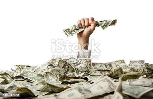 istock Fist full of money 516190135