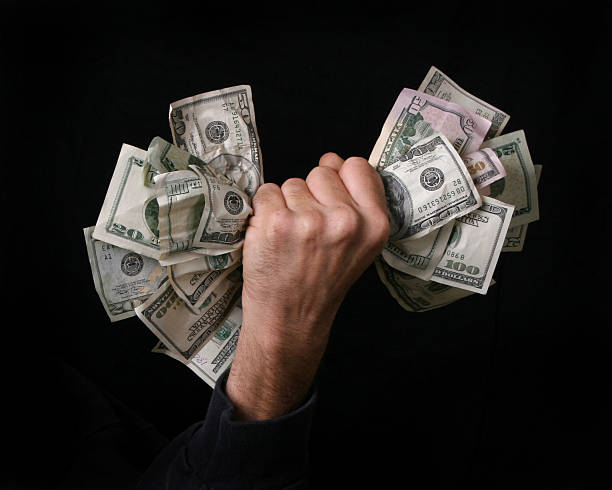 fist full of money  greed stock pictures, royalty-free photos & images