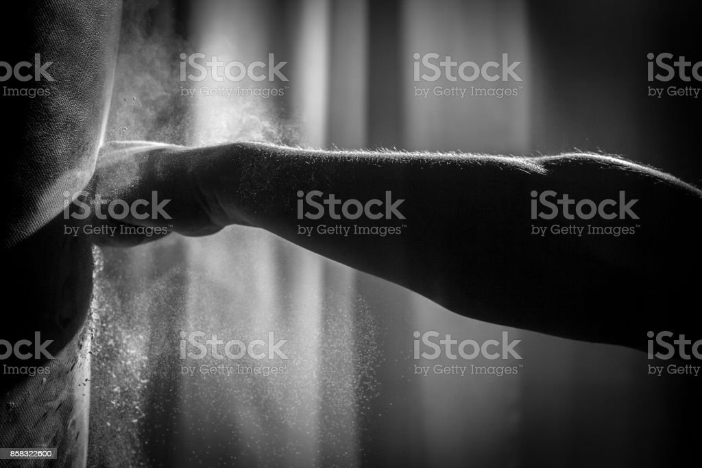 Fist Hitting a Punching Bag stock photo