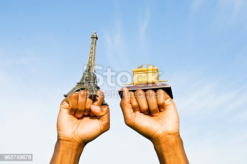 istock Fist Hold Up The Eiffel Tower And Ark Of The Covenant Replica 965749678