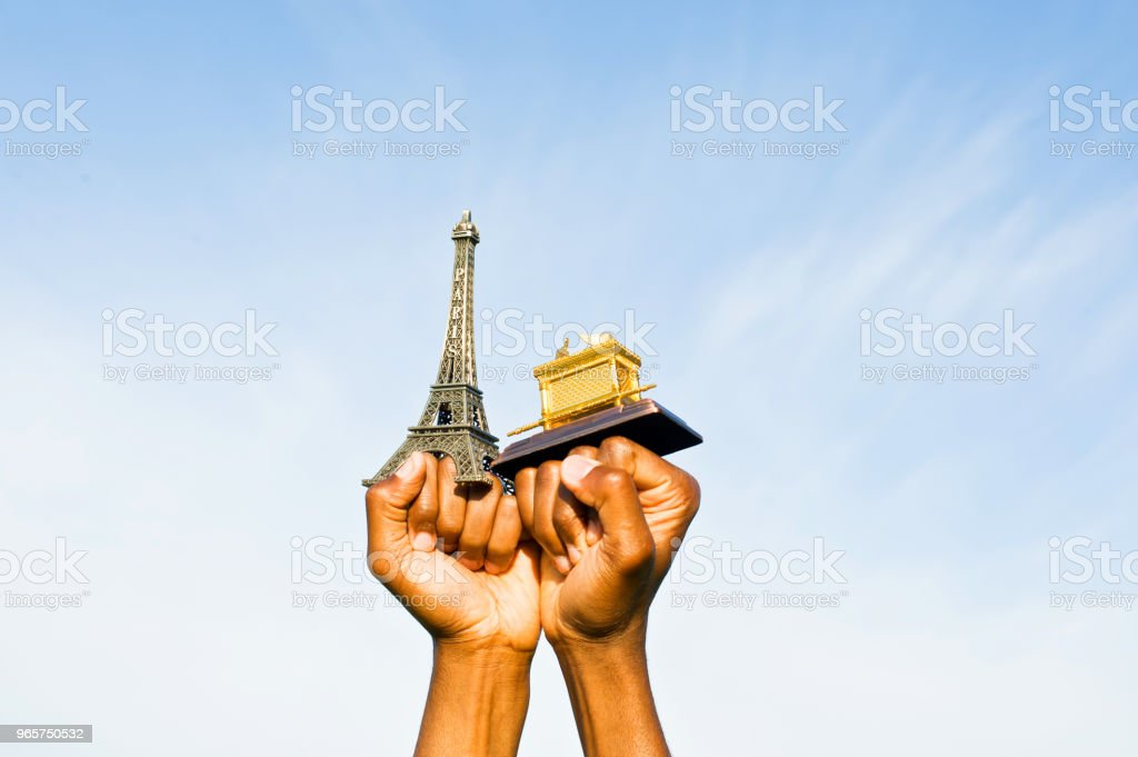 Fist Hold Up The Eiffel Tower And Ark Of The Covenant Replica Fist Hold Up The Eiffel Tower Replica Adult Stock Photo
