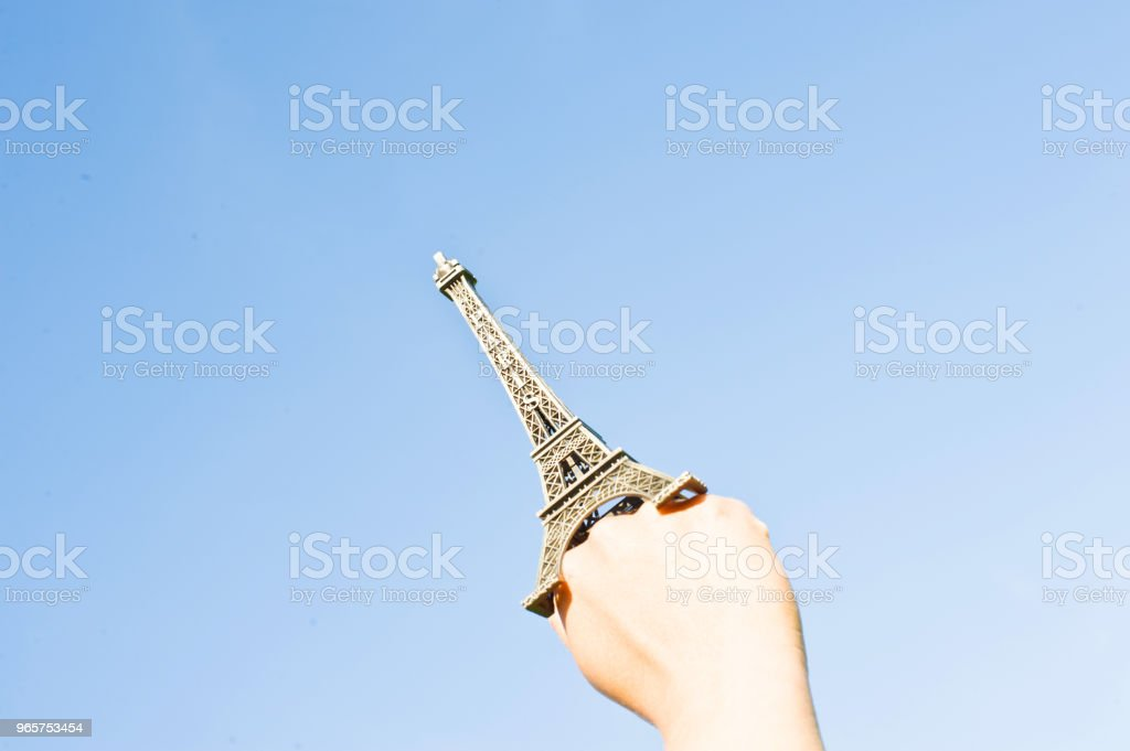 Fist Hold Up The Eiffel Tower Replica - Royalty-free Adult Stock Photo