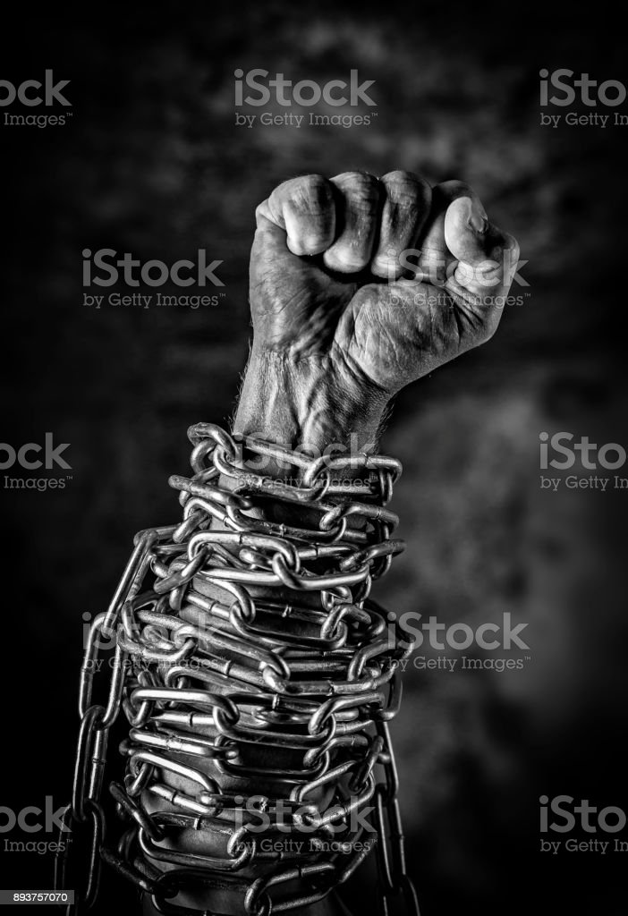 Fist in chains stock photo