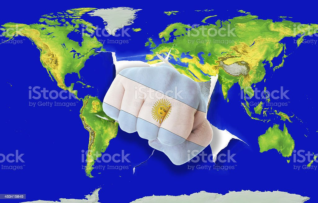 Fist in color national flag of argentina punching world map royalty-free stock photo