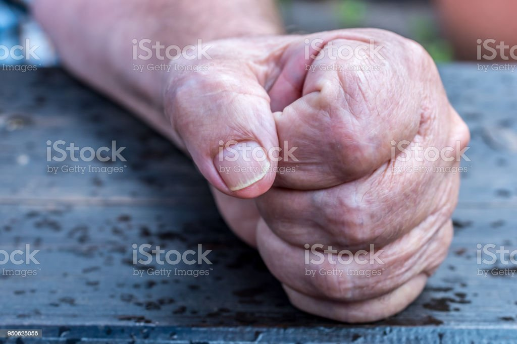 Fist of an old man stock photo
