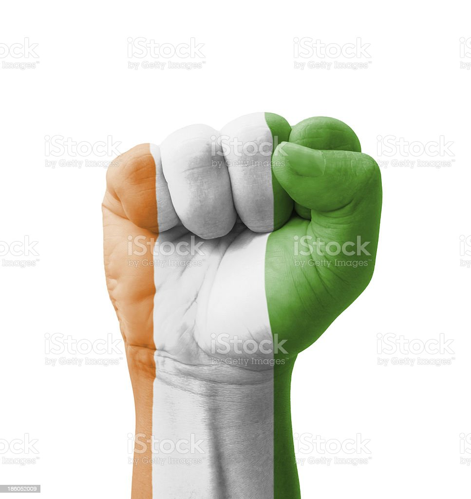 Fist of Ivory Coast flag painted, multi purpose concept royalty-free stock photo