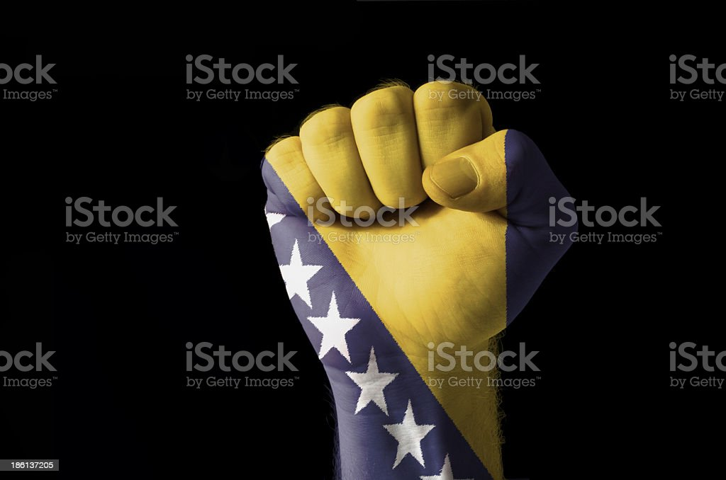 Fist painted in colors of bosnia and herzegovina flag royalty-free stock photo