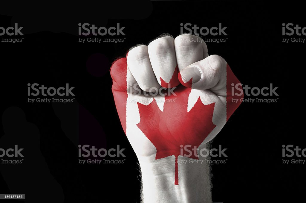 Fist painted in colors of canada flag royalty-free stock photo