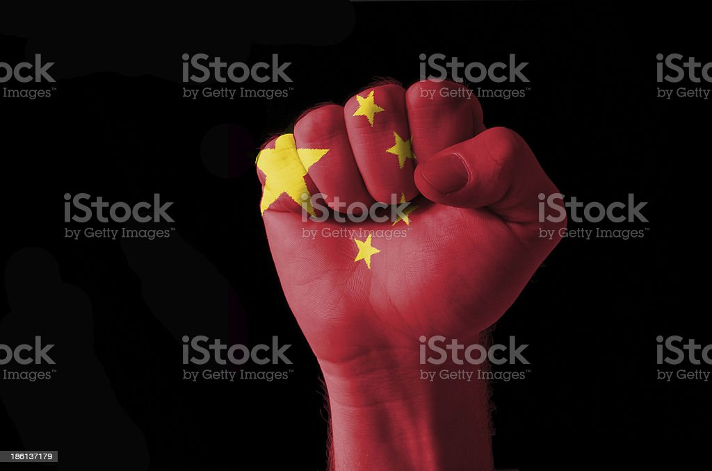 Fist painted in colors of china flag royalty-free stock photo