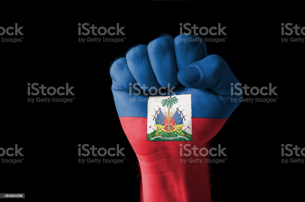 Fist painted in colors of haiti flag stock photo