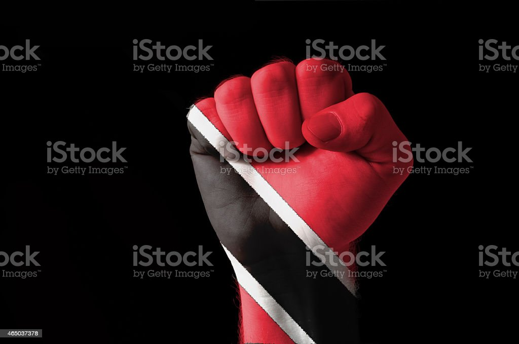 Fist painted in colors of trinidad tobago flag stock photo