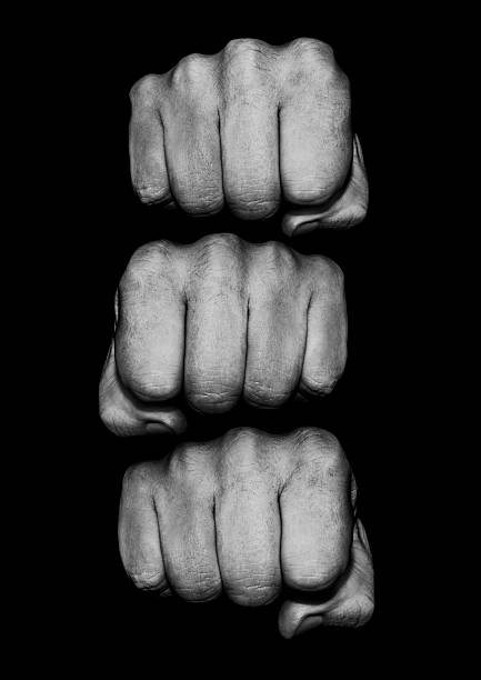 fist pile - fist stock photos and pictures