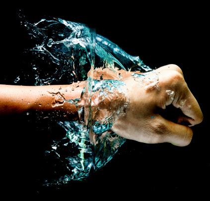 istock Fist punch into water with big splashes 491911259