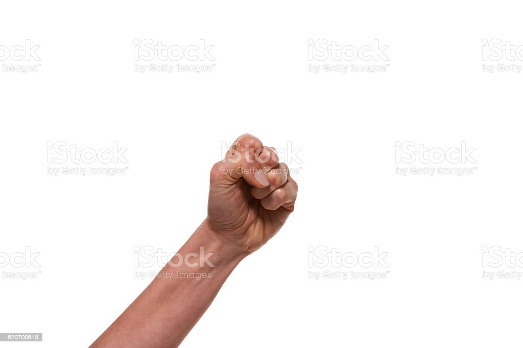 Fist punching the air stock photo