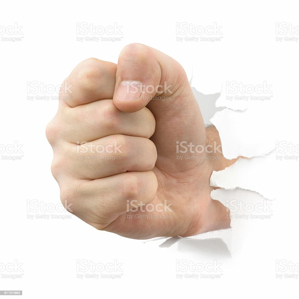 Fist punching thru paper royalty-free stock photo