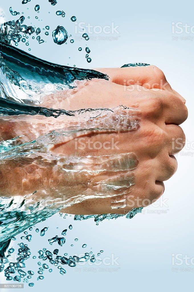 Punho através da água foto royalty-free