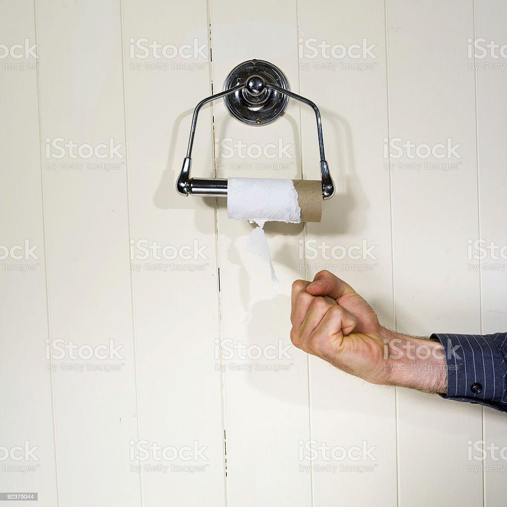 fist toilet roll stock photo