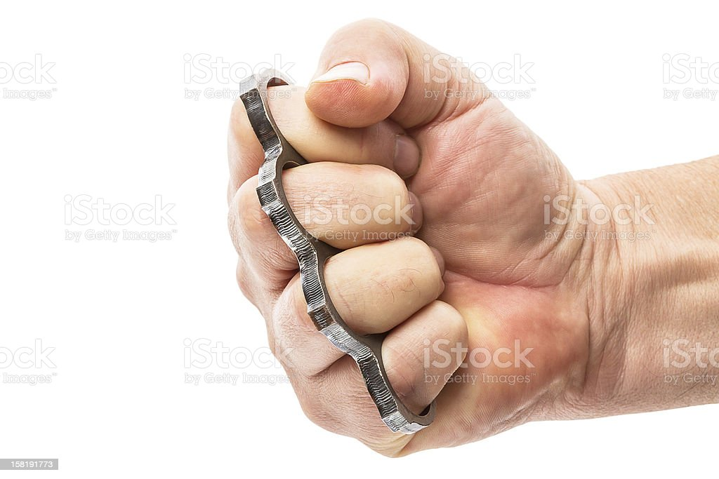 Fist with brass knuckles stock photo