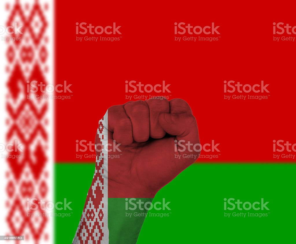 Fist wrapped in the flag of Belarus stock photo