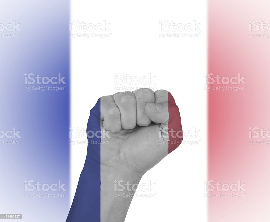 Fist wrapped in the flag of France stock photo