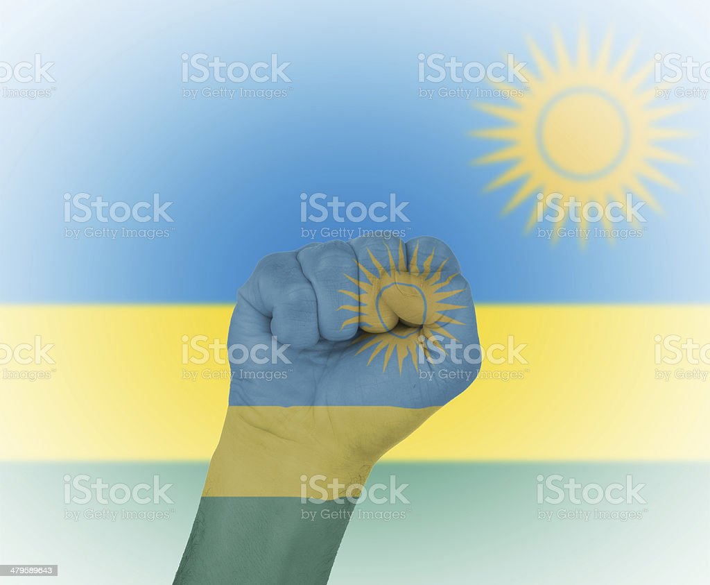 Fist wrapped in the flag of Rwanda stock photo