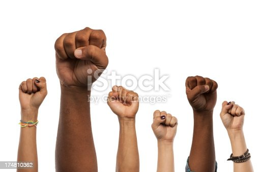 Six arms and fists raised in the air isolated against a white background.  Multiple skin tones and ethnicity. Power to the people!