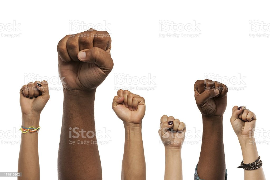 Fists and Arms raised in unison against white stock photo