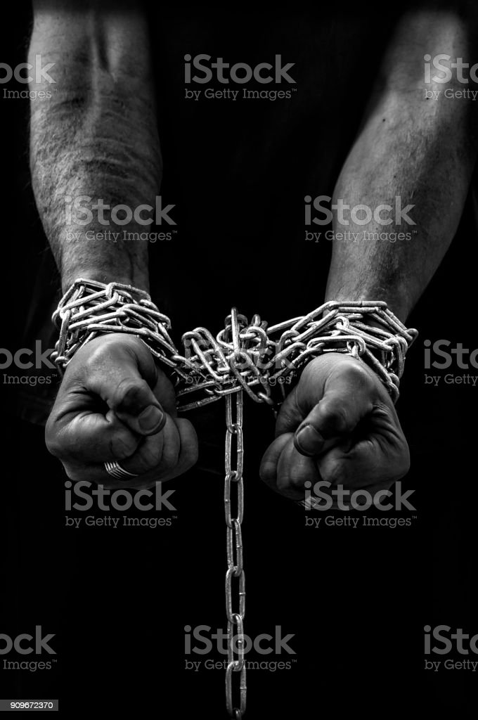 Fists in chains stock photo