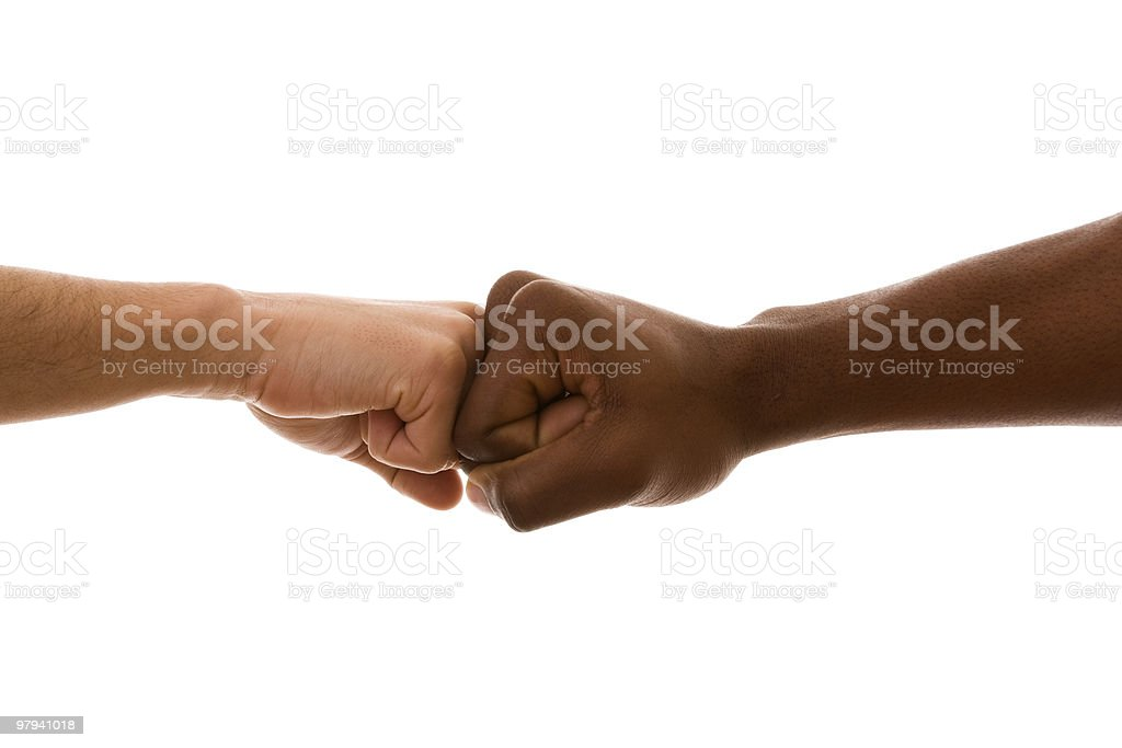 Fists of different races stick together defying racism royalty-free stock photo