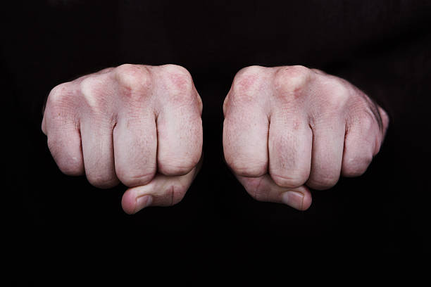 fists - knuckle stock photos and pictures