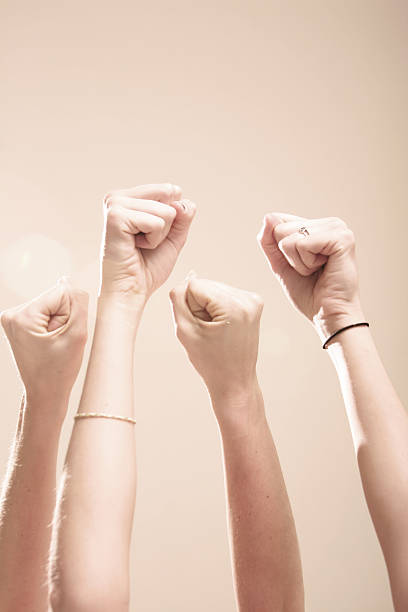 Fists Raised Up in Air stock photo