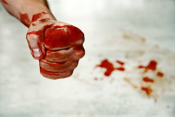fists with blood. - knuckle stock photos and pictures