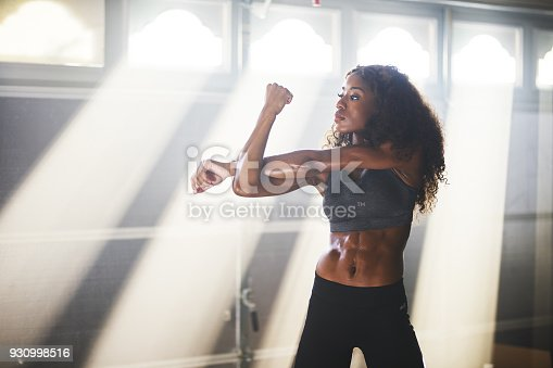 930998708 istock photo fit african american woman doing stretches before work out 930998516