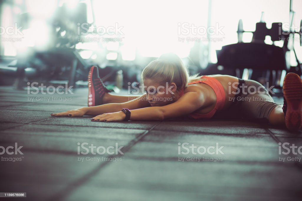 Fit and flexibility. Woman at gym.