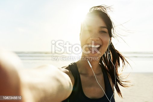 Cropped portrait of an attractive and athletic young woman working out on the beach