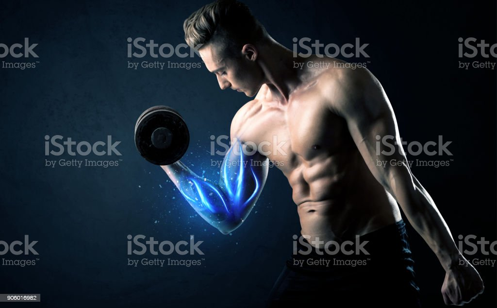 Fit athlete lifting weight with blue muscle light concept stock photo