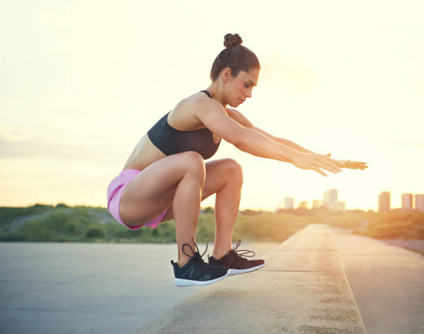 Fit athletic woman exercising stock photo