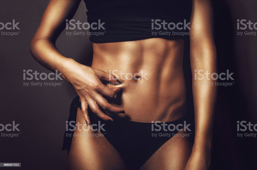 Fit Athletic Woman Pinching Her Stomach Skin Showing Perfectly Shaped Abs And Body With No Cellulite Stock Photo Download Image Now Istock