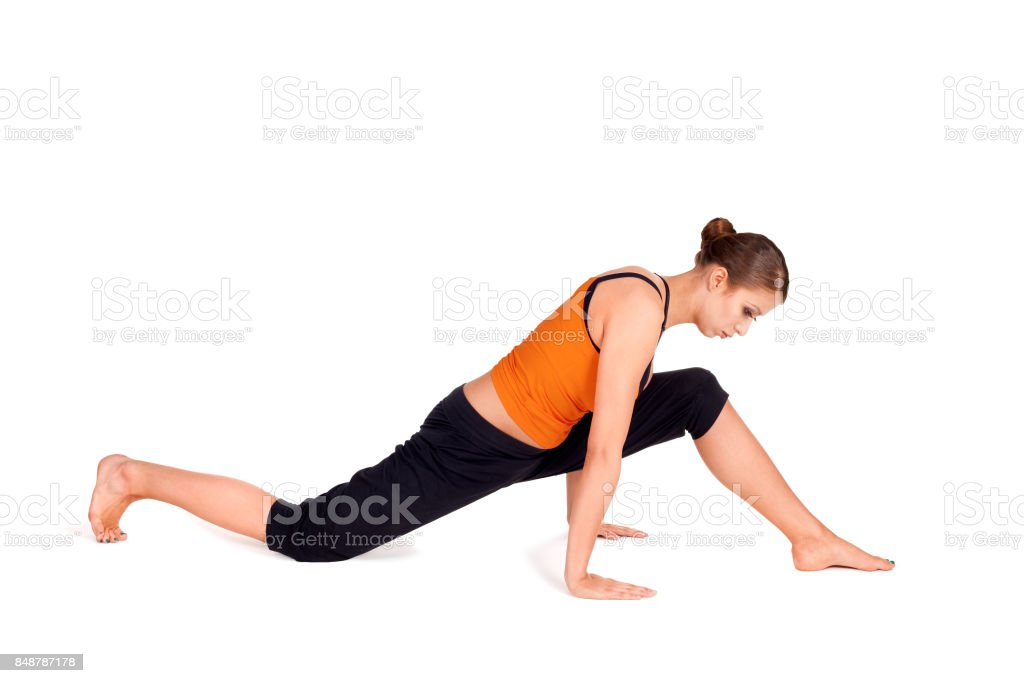Fit Attractive Woman Practicing Yoga Pose stock photo