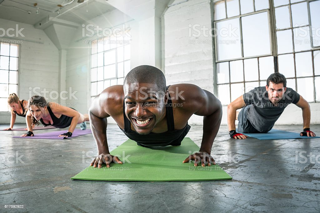 Fit big muscles exercising fitness push ups strong powerful intensity stock photo