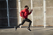 istock Fit black sporty man training in the city. 1295949061