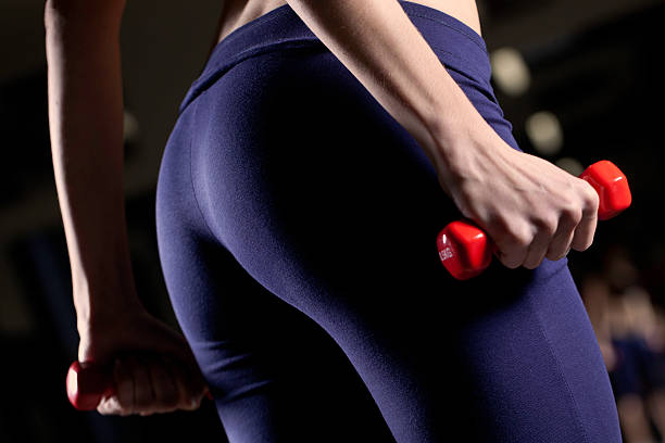 Fit Buttocks And Red Dumbbells stock photo