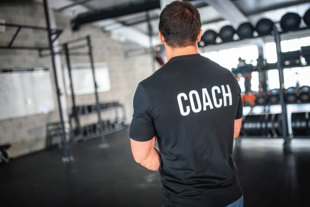 Fit Caucasian Male Coach Standing in Cross Training Gym stock photo