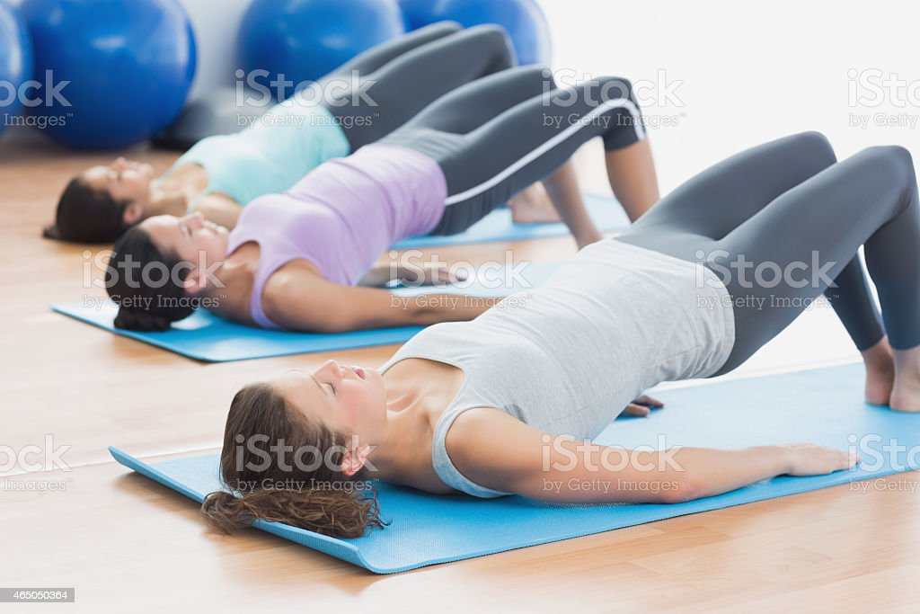 Fit class exercising at fitness studio stock photo