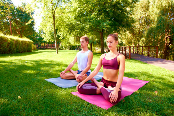 Cтоковое фото Fit couple doing yoga together outdoor