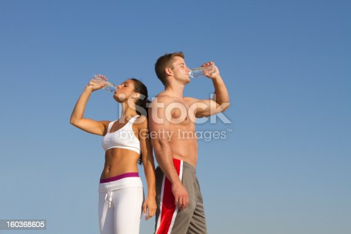 istock fit couple drinking water outdoors 160368605