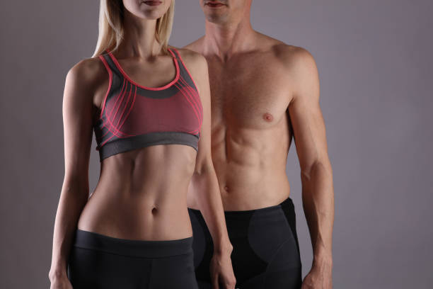 fit couple, strong muscular man and slim woman . sport, fitness ,workout concept. copy space - woman muscular stock photos and pictures