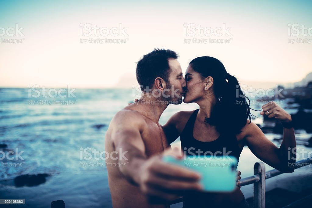 Fit couple taking selfie with smart phone after workout stock photo
